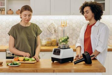 Two women making smoothie